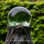 statue with glass globe
