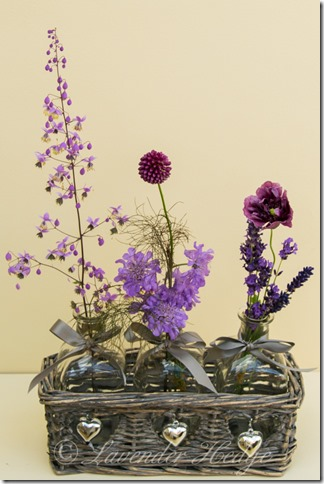 Flower arrangement in bottles