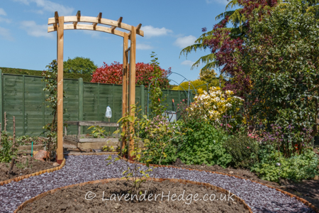 wooden rose arch, circular island bed